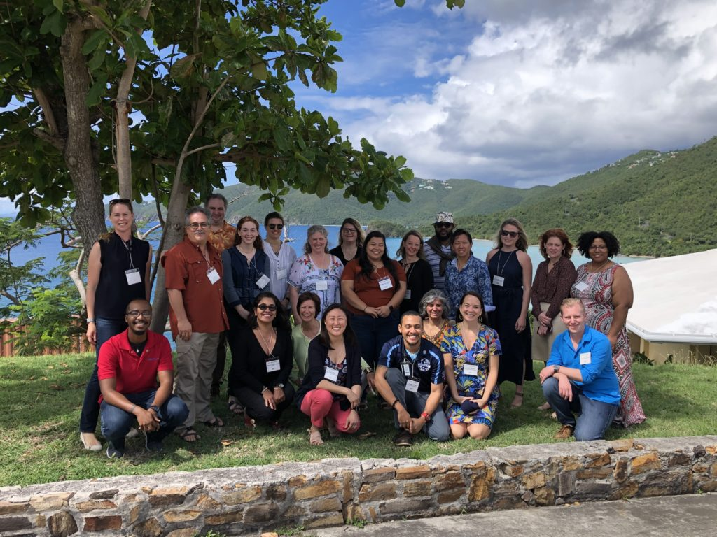 Group photo at the SEAS Islands Alliance Kick-off Meeting at the University of the Virgin Islands, with the sea and hills visible behind